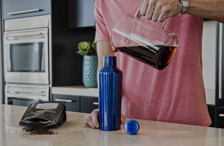 Pouring Coffee In Travel Mug