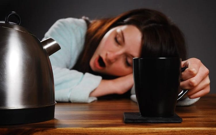 tired woman after cup of coffee